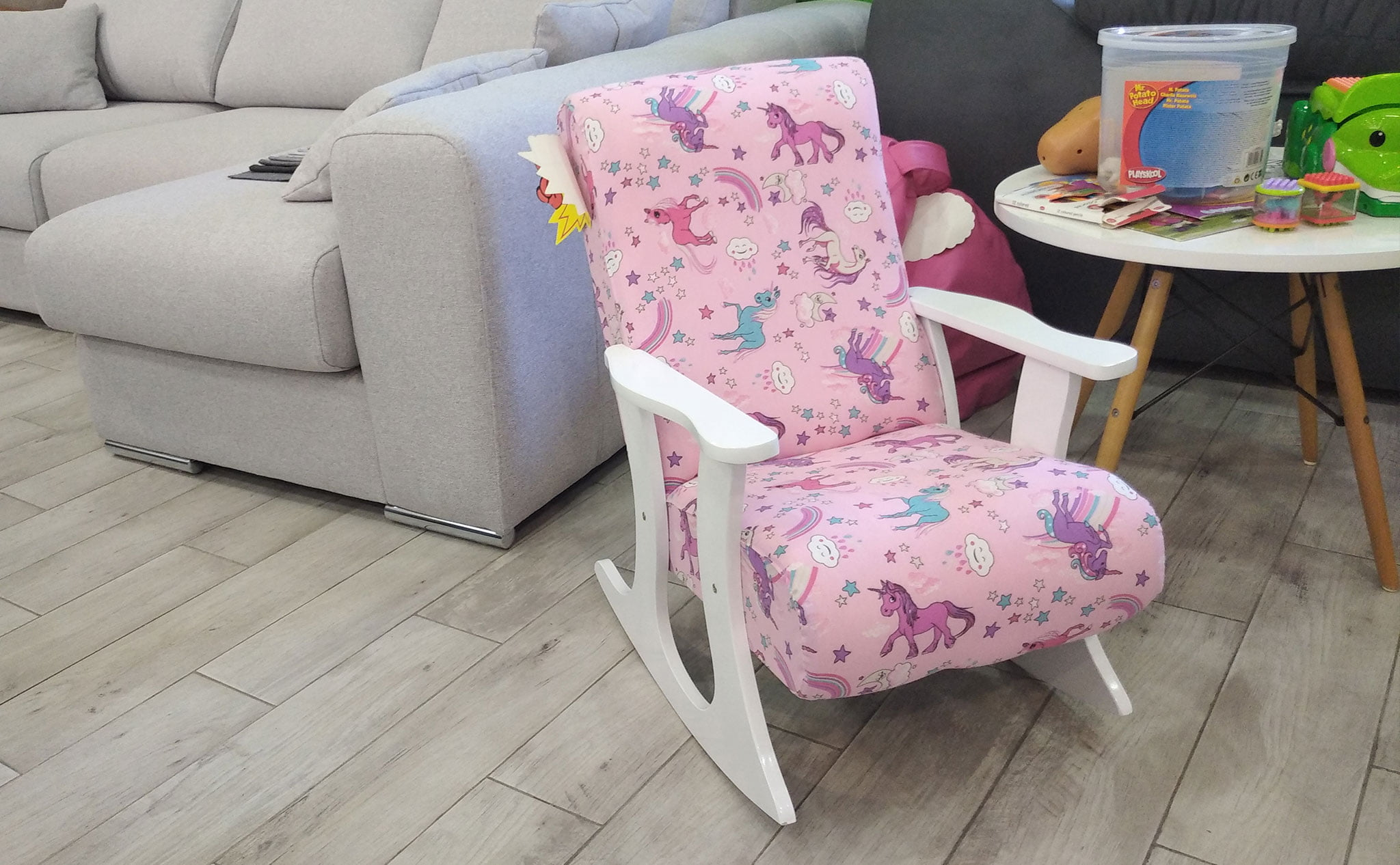 Pink children's rocking chair at stake in the OK Sofas draw