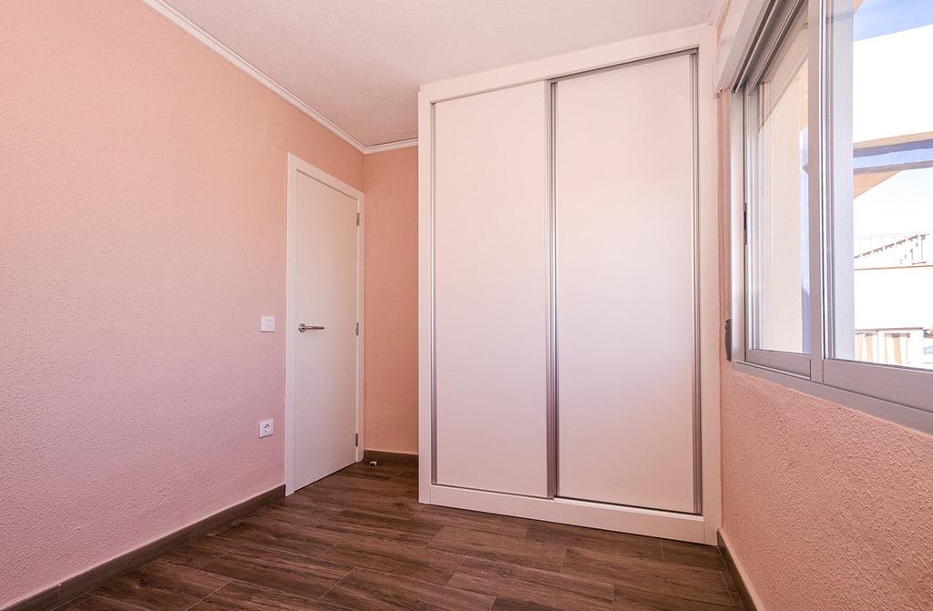 Habitación rosa Reformas Integrales Macamon