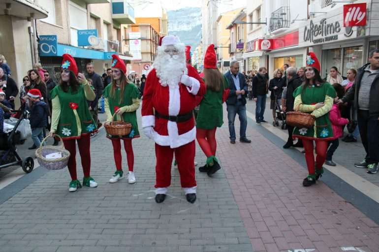 Santa Claus with his elves