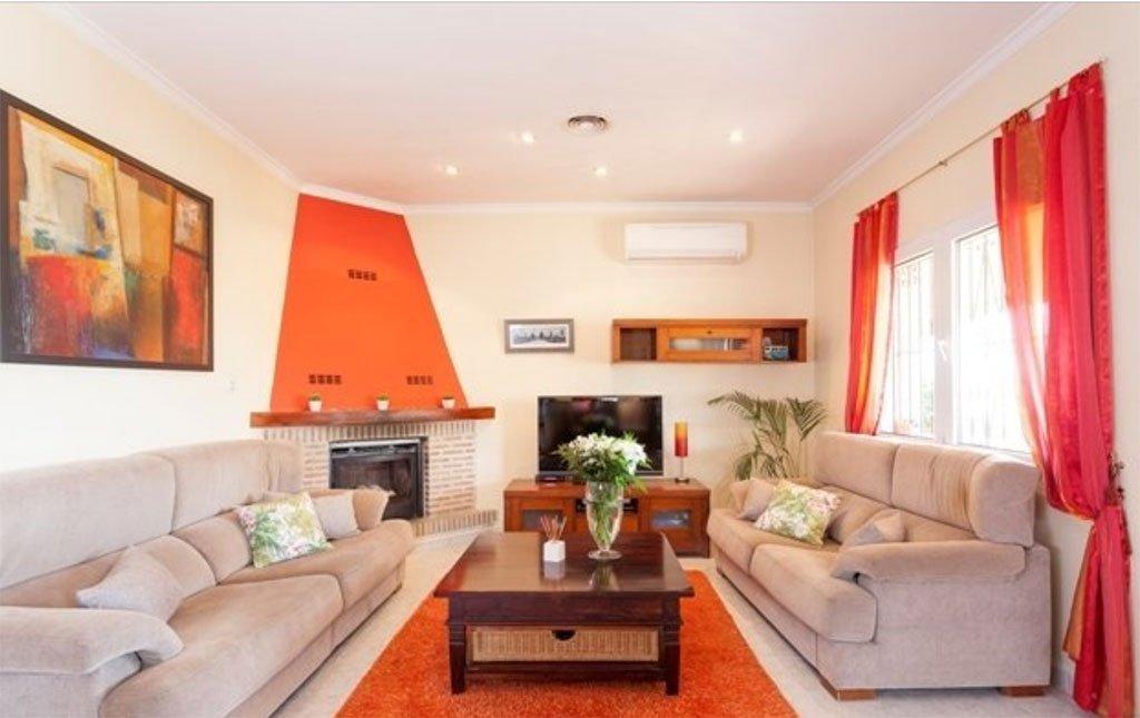 Sala con chimenea vacation villas
