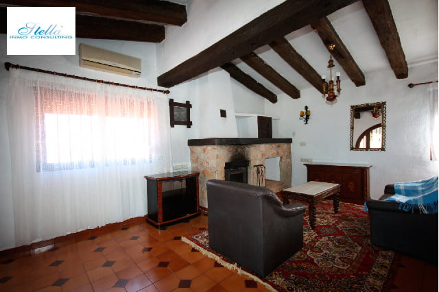 Living room with fireplace Stella Inmo Consulting