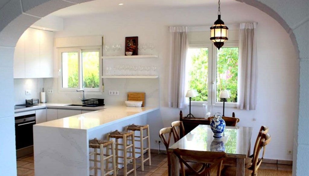 Cucina aperta con zona pranzo - Stirling Ackroyd Spagna