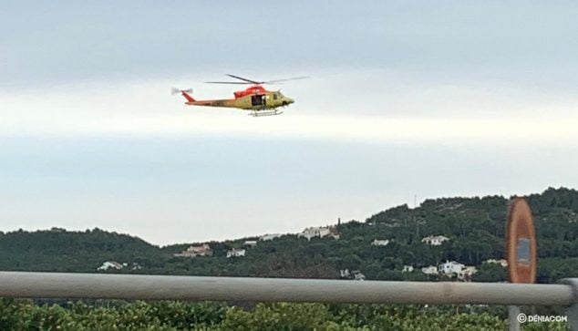 Image: Fire helicopter flying over the area