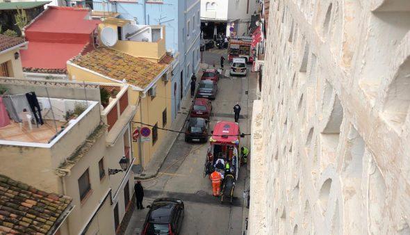 Image: Ambulance treats a fire-injured person