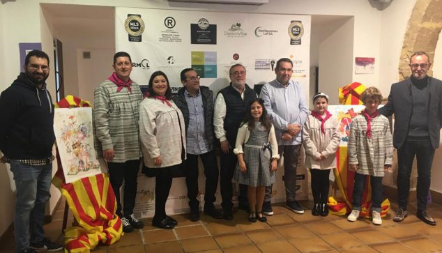 Image: Falleros and artists pose next to the work