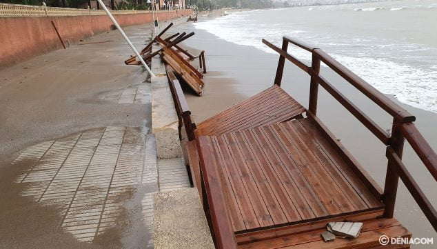 Image: The wooden stairs that connect walk with sand are very damaged