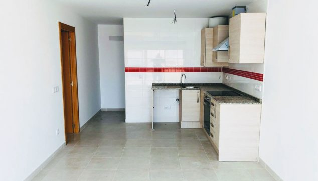 Image: American kitchen in a one bedroom apartment for sale in Ondara - Mare Nostrum Inmobiliaria