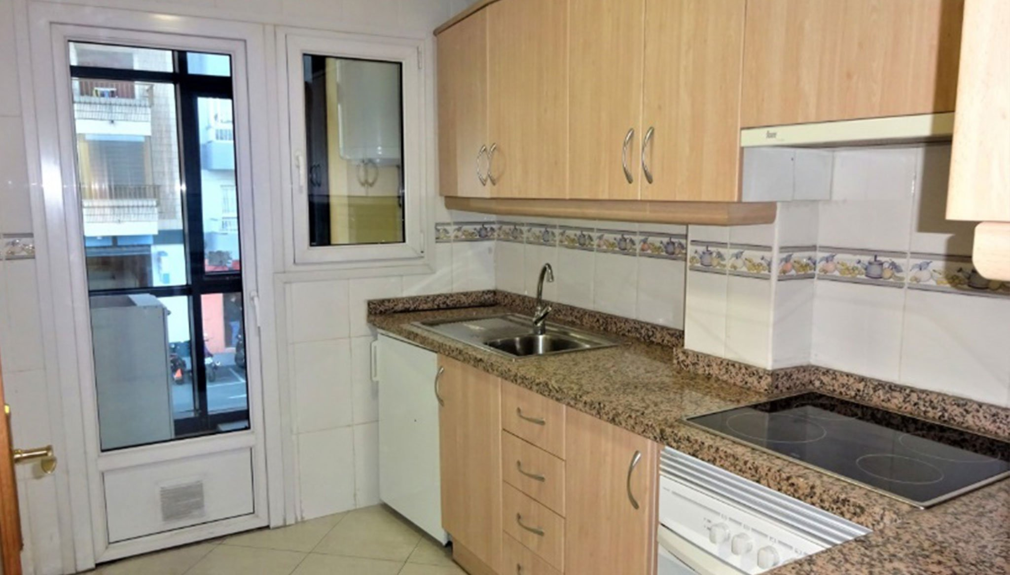 Kitchen of an apartment for sale in Dénia - Singular Homes