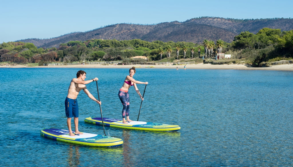 Couple practicing Paddle Surf