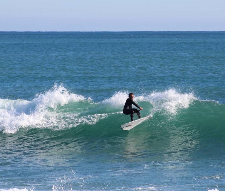 Rider with rowing surf