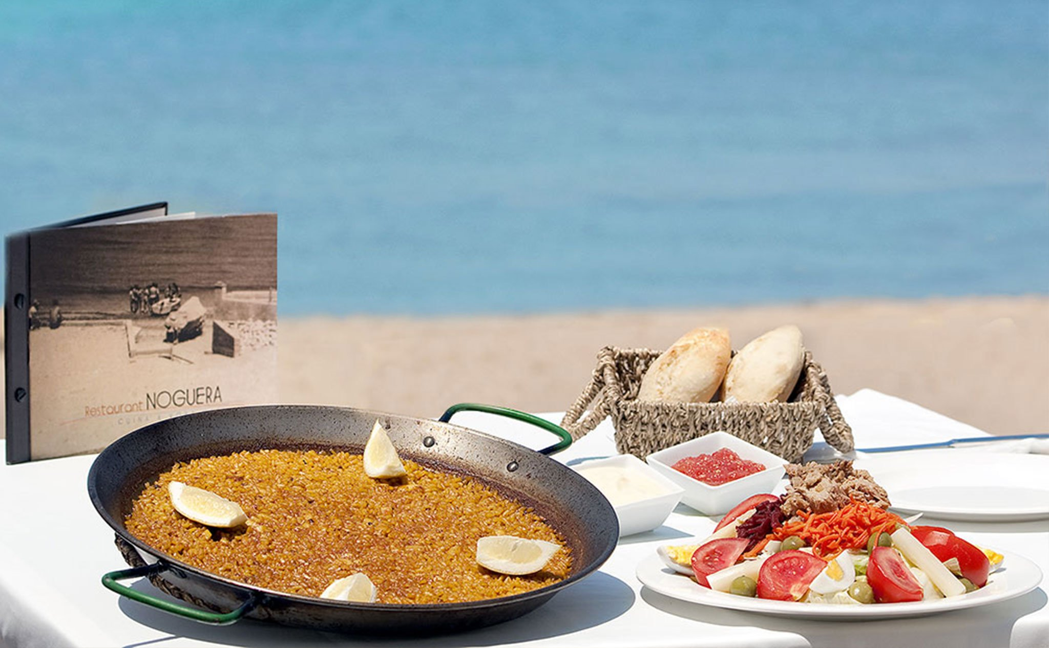 Eating rice on the beach in Dénia - Restaurant Noguera