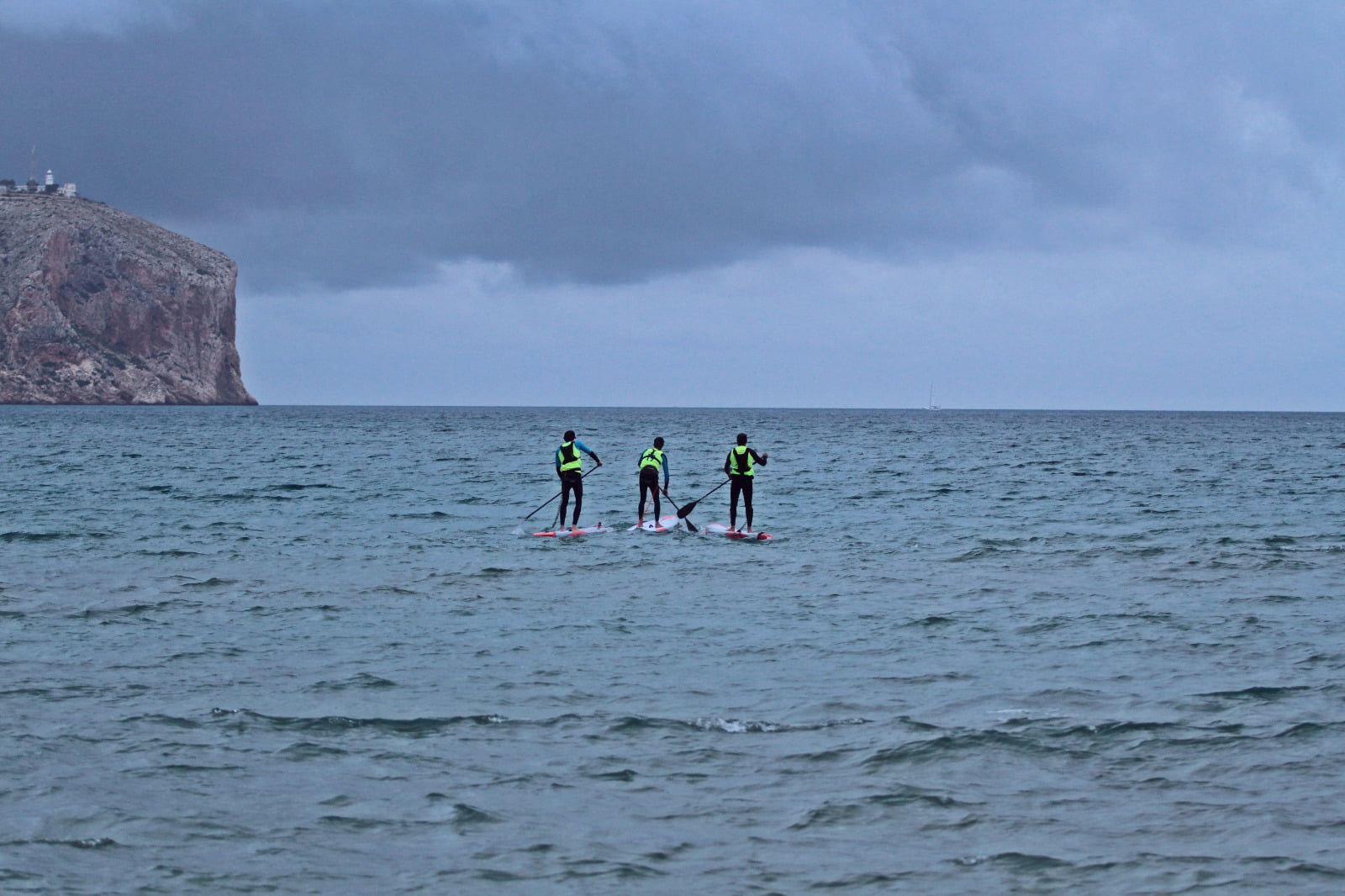 SUP rider on winter day, with thermal clothing, hydration and and bright colors