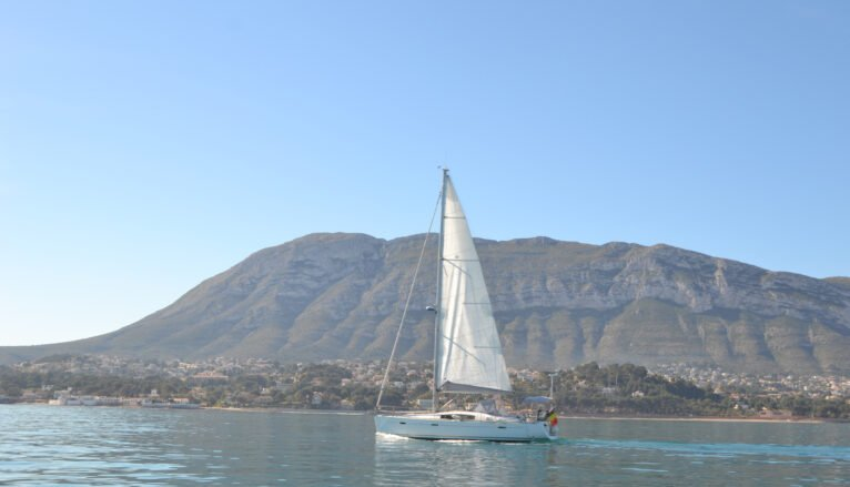 Sailboat in front of the Montgó
