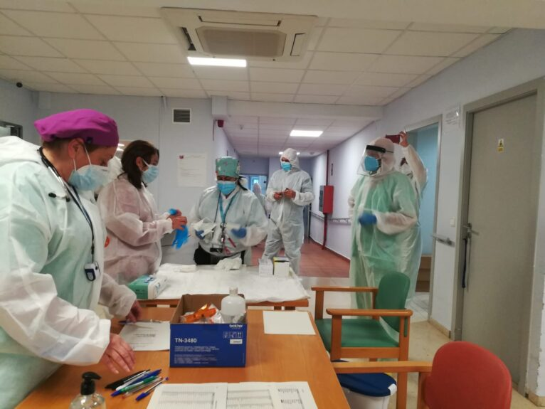 Staff preparing the vaccine